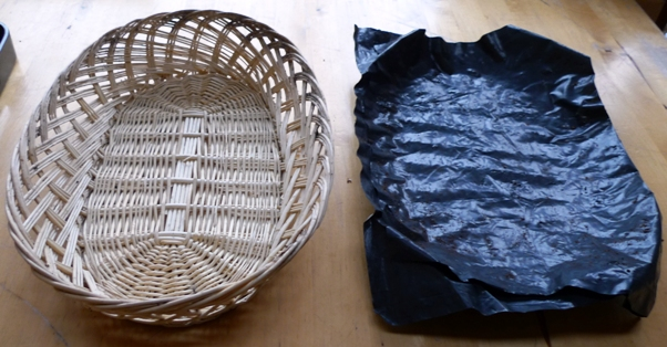 line a basket with plastic to use it to grow bulbs